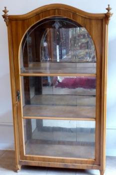 Walnut showcase, with arch and etched glass